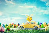 Retro toy car with Easter egg on the roof in fairytale spring scenery. Hand painted eggs. The car is poster