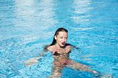 Summer Vacation And Travel To Maldives. Sexy Woman In Swimming Pool. Sexy Girl With Red Lips And Wet poster