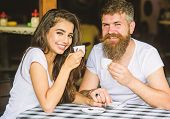 Enjoy Moment With Cup Of Coffee Drink. Man With Beard And Attractive Happy Smiling Girl Hold Hands D poster