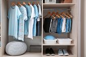 Stylish Clothes, Shoes And Home Stuff In Large Wardrobe Closet poster