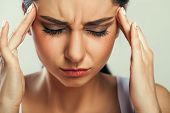 Health And Pain. Stressed Exhausted Young Woman Having Strong Tension Headache. Closeup Portrait Of  poster
