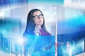 Pensive Young Woman In Glasses Holding A Book Standing In Business Interface With Virtual Screens. C poster