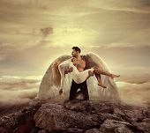 Fine art imagery. Woman and angel man embracing. poster