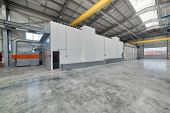 Large, Spacious And Light Factory Workshop. Large Spray Booth Inside The Workshop. poster