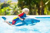 Child In Swimming Pool. Kid On Inflatable Float poster