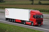 picture of delivery-truck  - A Red and White truck on the road near the Port of Antwerp - JPG