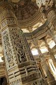 picture of jainism  - Detail on a pillar at Chaumukha Mandir the main jain temple at Ranakpur India - JPG