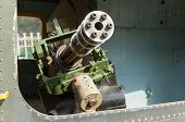 picture of attack helicopter  - Chaingun in an old American helicopter used in the Vietnam war on display in Saigon  - JPG