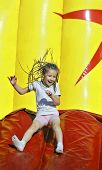 picture of inflatable slide  - Girl with inflatable slides slides - JPG