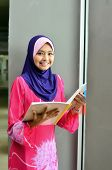 pic of muslimah  - Young asian muslim woman in head scarf smile with confident pose - JPG