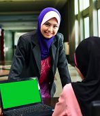 stock photo of muslimah  - Young asian muslim woman in head scarf smile with confident pose - JPG