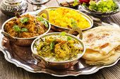 stock photo of curcuma  - indian curries with rice and bread  - JPG