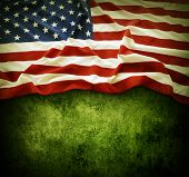 Closeup of American flag on grunge background. Copy space