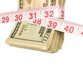 foto of inference  - A bundle of cash being squeezed tighter due to the recession - JPG