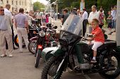 boy sit on retro bike Ural