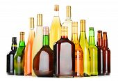 foto of ethanol  - Bottles of assorted alcoholic beverages isolated on white background - JPG