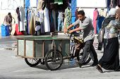 Man Pushing A Tricycles