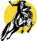 foto of bucking bronco  - Vector illustration of a rodeo cowboy on horseback - JPG