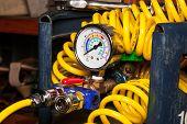 stock photo of air pressure gauge  - Pressure gauge on empty air tank with spiral air tube - JPG