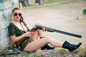 picture of  boobs  - Sexy military woman model with weapon outdoors - JPG