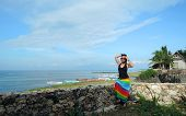 picture of filipina  - Filipina watching the ocean from a cliff resort