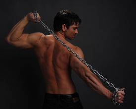 picture of paranormal  - a sexy man stands holding a chain - JPG