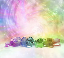 picture of colorful banner  - Selection of rainbow colored crystals on a rainbow colored swirling energy background with sparkles  - JPG
