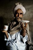 picture of rajasthani  - Portrait of a Rajasthani Indian man at an early morning market - JPG