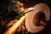 picture of sparking  - Close up shot of sparks from grinding wheel - JPG