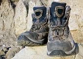 stock photo of welts  - Tourists boots on stone in mountains  - JPG