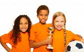 picture of prize  - Close portrait of soccer team divers looking team of little boy and girls holding prize cup and football ball smiling and cheering isolated on white - JPG
