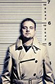 image of stature  - Killer standing on height ruler for photo in prison - JPG