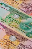 picture of dirhams  - Different Dirham banknotes from Emirates on the table - JPG