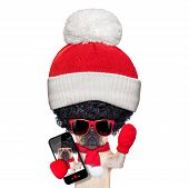picture of christmas dog  - fawn french bulldog dog wearing winter clothing taking a selfie very proud of its big curly afro wig hair isolated on white background a really silly and crazy dumb look - JPG