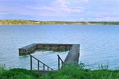 pic of kama  - Stairs down to wooden pier at great river Kama in evening summer - JPG