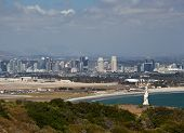 pic of conquistadors  - Skyline of San Diego in background behind statue of Cabrillo on Point Loma - JPG