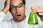 pic of mad scientist  - Crazy scientist holding green liquid in test tube - JPG