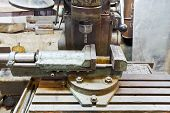 picture of locksmith  - vice and drill of old boring machine close up in locksmith workshop - JPG
