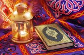 pic of quran  - A beautiful image of Ramadan lantern beside Quran with golden rays - JPG