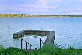 stock photo of kama  - Stairs down to wooden pier at great river Kama in evening summer - JPG