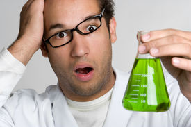 image of mad scientist  - Crazy scientist holding green liquid in test tube - JPG