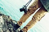 Постер, плакат: Traveler With Camera Standing On Coast