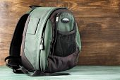 foto of knapsack  - Backpack on wooden background - JPG