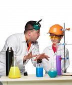 stock photo of chemistry  - Teen and teacher of chemistry at chemistry lesson making experiments isolated on white background - JPG