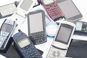 foto of outdated  - Old and new Mobile phones and smartphone - JPG