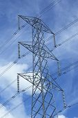 picture of transmission lines  - Top view of a transmission tower with high voltage power lines insulators and conductors - JPG