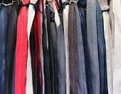 stock photo of zipper  - Bunch of colorful zippers sold on market - JPG