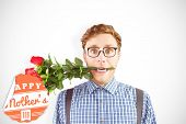stock photo of love bite  - Geeky hipster biting a bunch of roses against mothers day greeting - JPG
