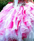 stock photo of quinceanera  - Quinceanera gown worn by a young teenager at her coming out ceremony - JPG