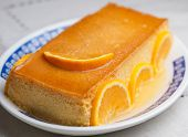 stock photo of custard  - Orange custard in a studio shot - JPG